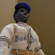 Cover image of JWIC: Dolls for Democracy figurine - Jackie Robinson. Biography is included.
