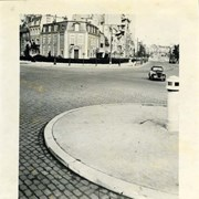 Cover image of Car driving on cobblestone city street, France, World War II.