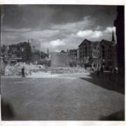 Cover image of Brick street leading to demolished buildings, World War II, France.