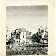 Cover image of Bombed out buildings in rural area, World War II, France.