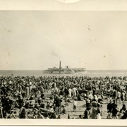 Cover image of Beach Scene, Steamboat along horizon line, onlookers dressed in beachware