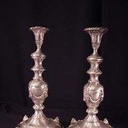 Cover image of Shabbat candlesticks decorated with foliage, ribbons and masks